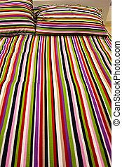 Striped bed - a cheerful striped bed in a domestic bedroom