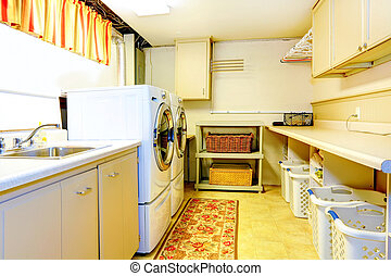 Big old style laundry room with modern appliances and wicker...