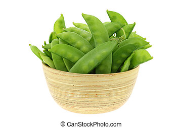 Fresh Peas in a wooden bowl - A bunch of fresh Peas in a...
