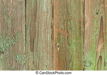 Old greeen wood plank background. Closeup.