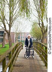 Elderly woman with walker
