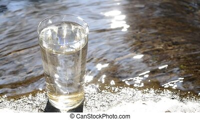 Glass and reflected light - Water in the glass and reflected...
