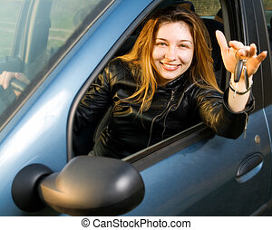 Happy woman with keys from her new car - Portrait of happy...