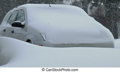 Car covered by snow.