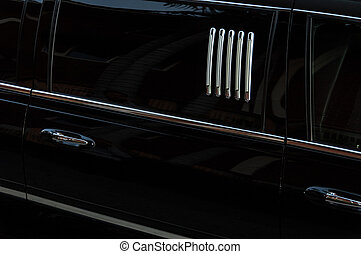 Limo - a detail of a black, shiny limo car