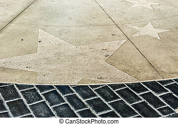 Hollywood stars - the paving of a walkway in hollywood with...