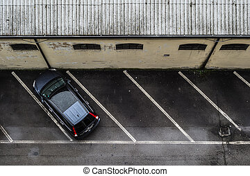 Parking alone - a small parking lot seen from above, with...