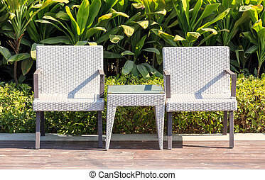 Outdoor furniture rattan armchairs and table on terrace in a...