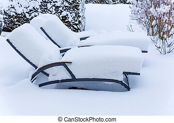 snow-covered garden furniture, symbolic photo for catering...