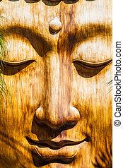 Zen Face - a zen wooden sculpture in an ancient oriental...