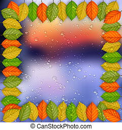 Frame of colored leaves with rain drops