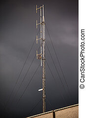 Antenna - a domestic antenna over a very dark and stormy sky