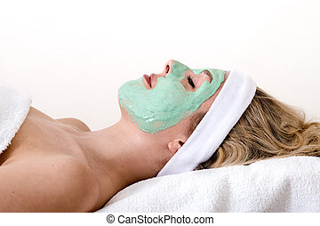 Blond woman enjoys facial beauty treatment - Beautiful blond...