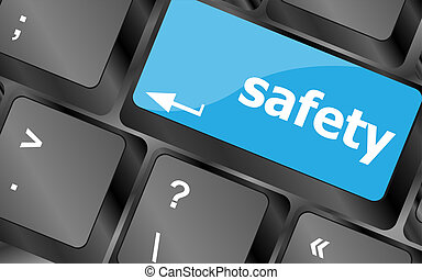 safety first concept with key on computer keyboard