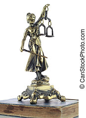 Justice Statue and old book. Lawyer background