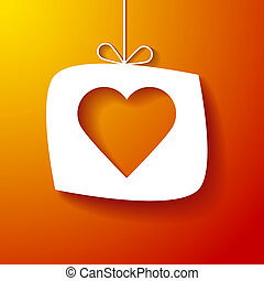 Paper heart on orange background