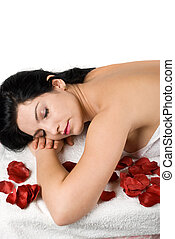 Spa massage - Close up of woman lying on massage table at...