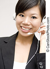 Friendly Customer Representative with headset smiling during...