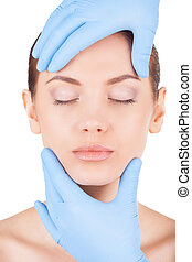 Preparation for surgery. Attractive young woman keeping eyes...