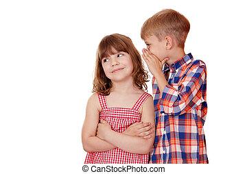 boy whispering a secret little girl on white
