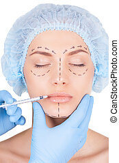 Botox injection in lips Beautiful young woman in medical...