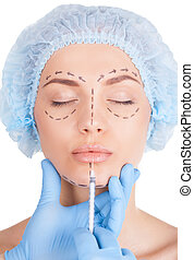 Lips improvement Attractive young woman in medical headwear...