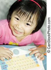 IT education - Happy learning Little asian girl with...