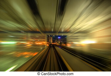 Speedy trains passing train station. Focus on the rail road....