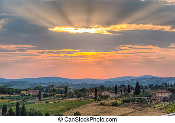 Tuscany sunset - a majestic sunset in a rural zone of...