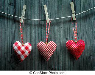 Valentine's Day wallpaper - Textile hearts hanging on the rope