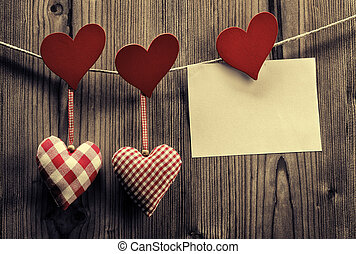 Valentine's Day wallpaper - Textile hearts hanging on the rope, message
