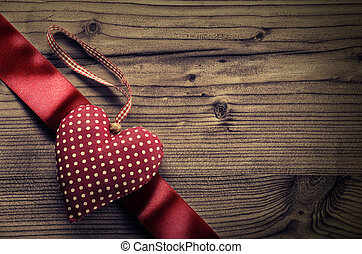 Dotted Fabric heart with satin ribbon wood background