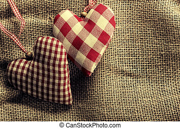 On canvas textile fabric hearts-wood background