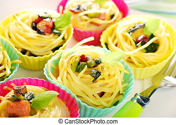 pasta nests baked in silicone muffin molds - pasta nests...