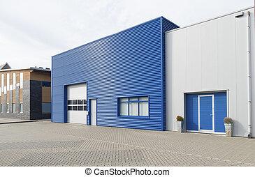 modern business unit - facade of a modern blue warehouse