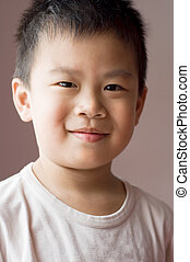 Asian young boy - Photo of Asian young boy looking at camera