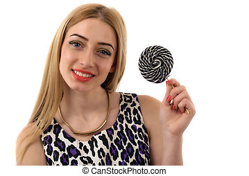 A young pretty woman with a lollipop over white