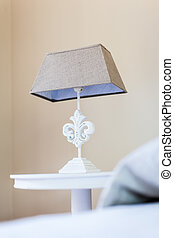 Bed Lamp - a bed side table with a classical style bed lamp...