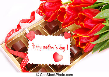happy mother`s day - red tulips and box of chocolates with...