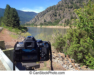 A DSLR Taking a Photo of a Wide Mountain River - Clark Fork...