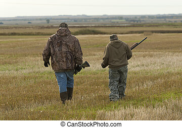 Grandfather and Grandson Hunting - A grandfather hunting...