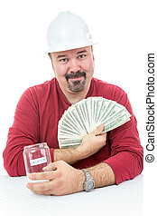 Construction worker holding vacations money