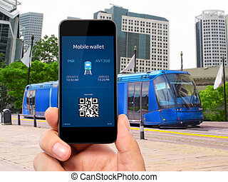man hand holding the phone touch with a mobile wallet and train ticket against the blue train to the city