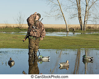 Duck hunter - A duck hunter using his duck call