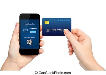 female hands holding phone and credit card making a purchase...