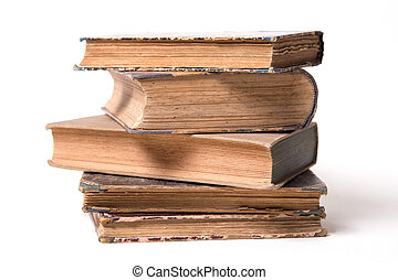 age-old books - few age-old books, standings alongside, on a...
