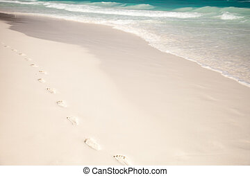 White beach, azure sea, waves and footsteps on perfect...