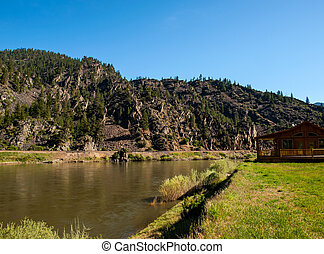 Wide Mountain River and a Log Cabin - Clark Fork River...