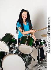 Smiling drummer - Beautiful smiling drummer woman playing...