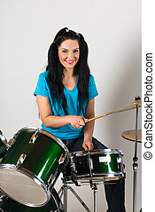 Beauty woman drummer - Young woman drummer playing music on...